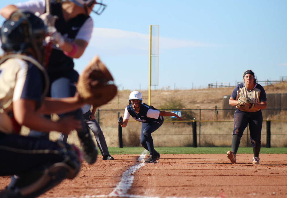 Valor freshman Savannah Behabetz leads off towards home plate against Frederick High School. Behabetz made it home and ended up being one of six runs on Valor Christian's side of the scoreboard. The final score of the quarterfinal matchup was 6-2, Valor Christian. Published October 2015, Highlands Ranch Herald