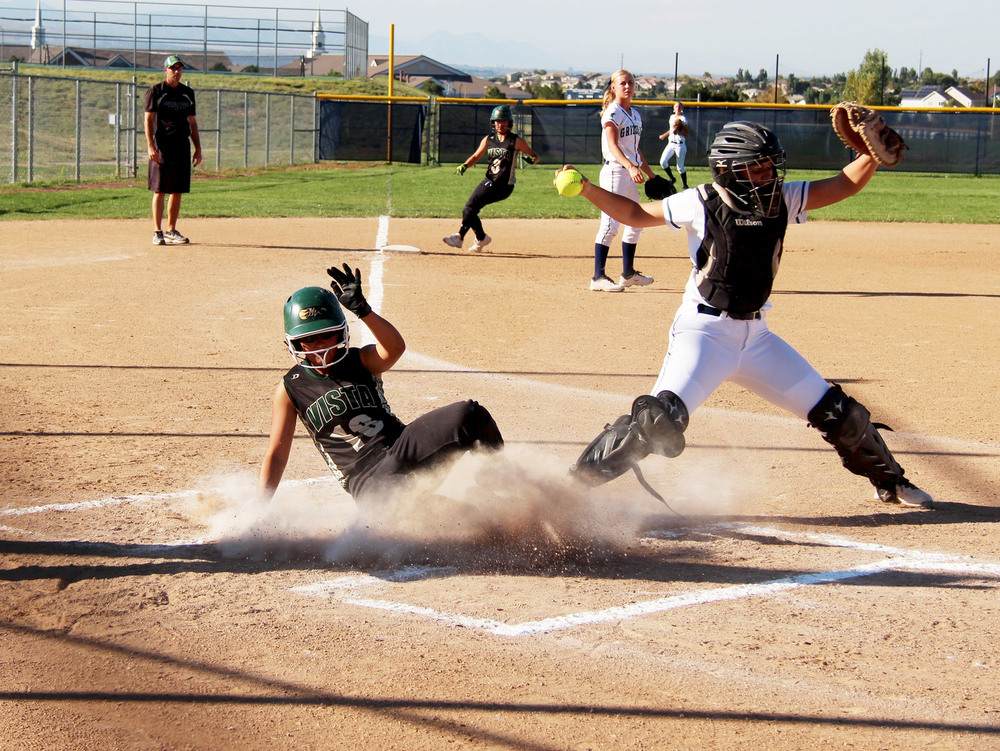 Freshman Rebecca Gonzales slides into home. Published September 2014, Vista Now