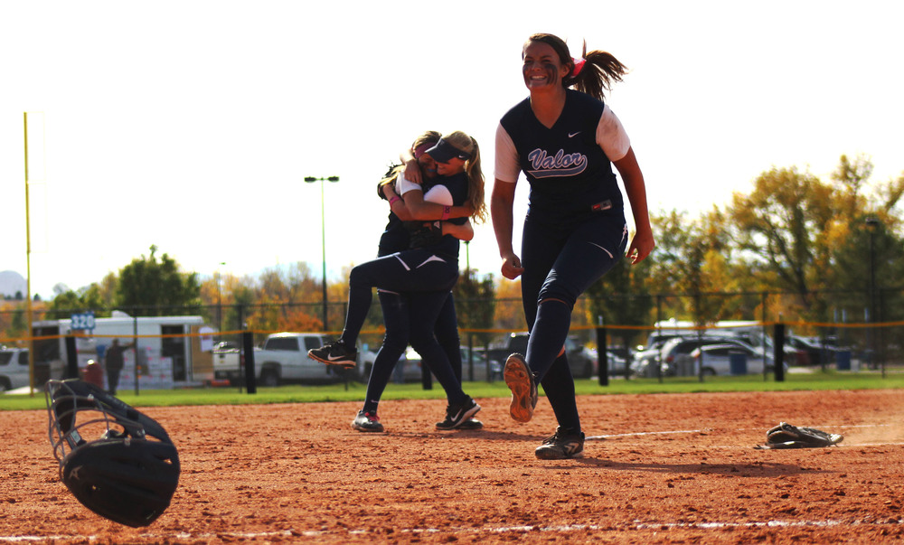Alexandra Kilponen rejoices after her teammate completes the last out. In the background, Kinder embraces Lauren Foster, the teammate she's grown closest to during the past couple months of the softball season.Published October 2015, Highlands Ranch Herald