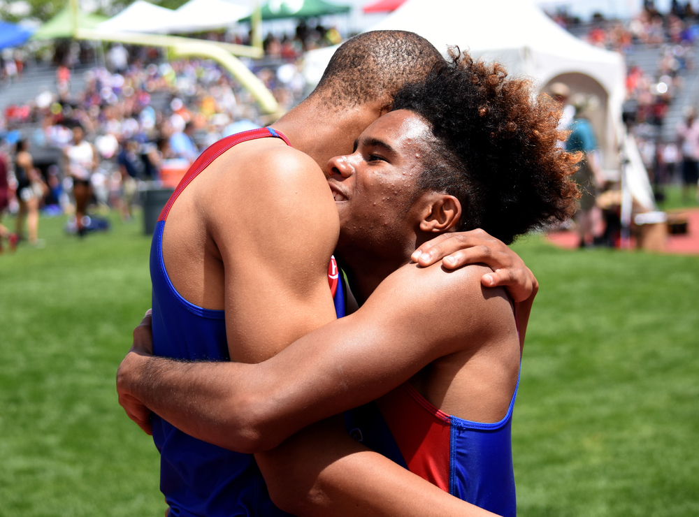 Senior Christian Lyon of Fountain-Ft. Carson, his teammate junior Donovan Williams embrace after placing first and second in the 200-meter dash.Published May 2016, Colorado Community Media