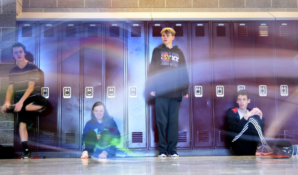 Members of Mountain Vista's ultimate frisbee team watch as their teammates run through the hallway.