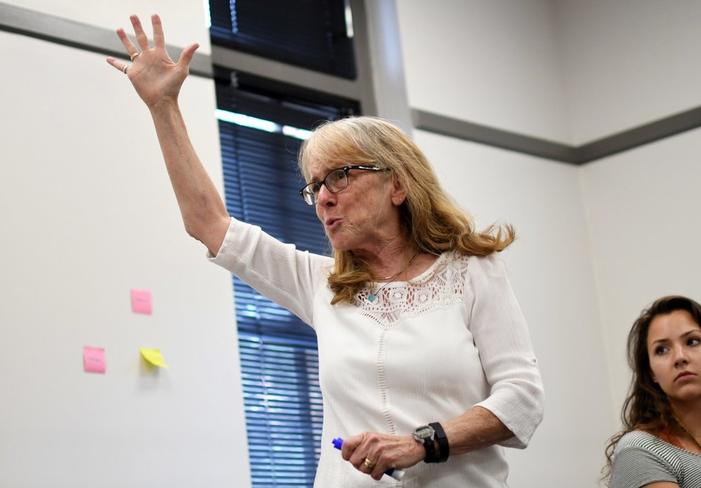 Karen Wyatt, a student academic success specialist, helps incoming freshman at the University of Colorado learn crucial study tips during a summer intensive workshop.