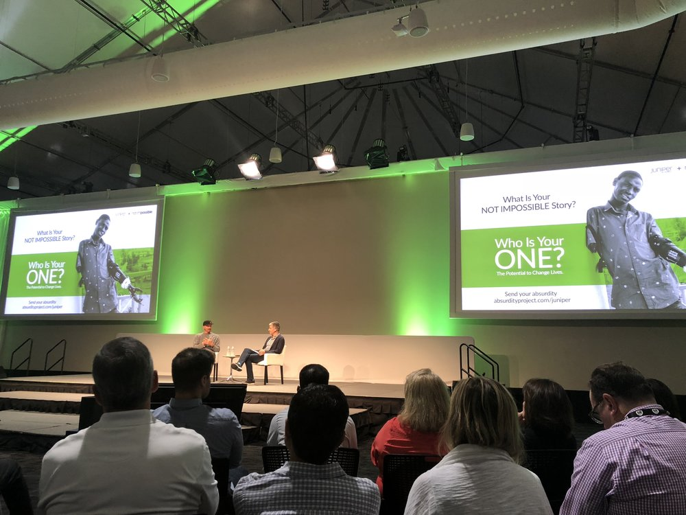 Juniper CEO Rami Rahim having a fireside chat with the founder of Not Impossible,Mick Ebeling.