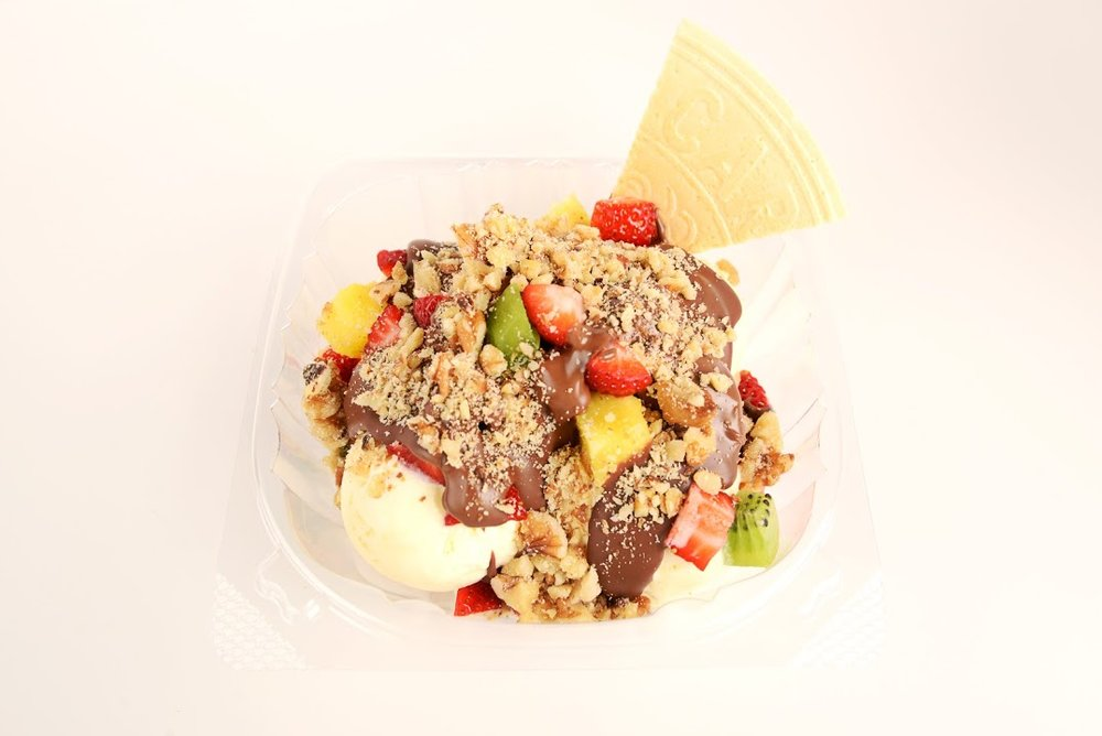 Chocolateka Ice Cream    - 3 ice cream scoops, 3 fresh fruits, Belgian Chocolate, topping, German cookie wafer (price may vary depending on fruit)$5.95