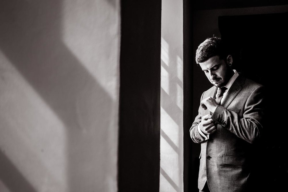 Groom portraits.  Great light and expresion can tell a wonderful story during a wedding.