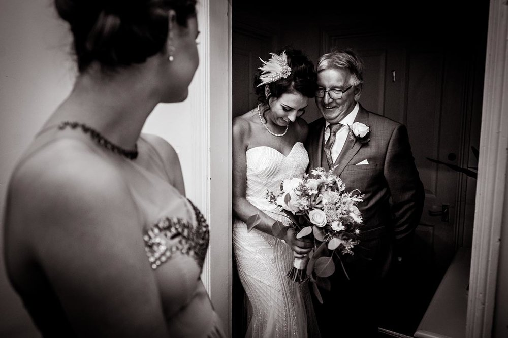 Bride with her Dad waiting to see her Groom
