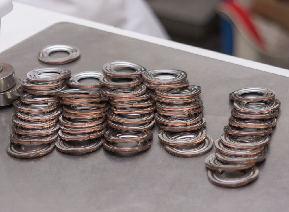 - Subsequent to the cleaning process, one male and one female diaphragm are welded together at the inside diameter to create a convolution.  At Metal-Flex, we have the capability to use Plasma or TIG welding to complete this task. Once the two diaphragms are welded together, chill rings are installed in each convolution.  The rings hold the ODs of the convolution apart to allow multiple convolutions to be welded together creating a bellows core.  Additionally, they serve to cool the weld, helping to make a clean and uniform weld bead.