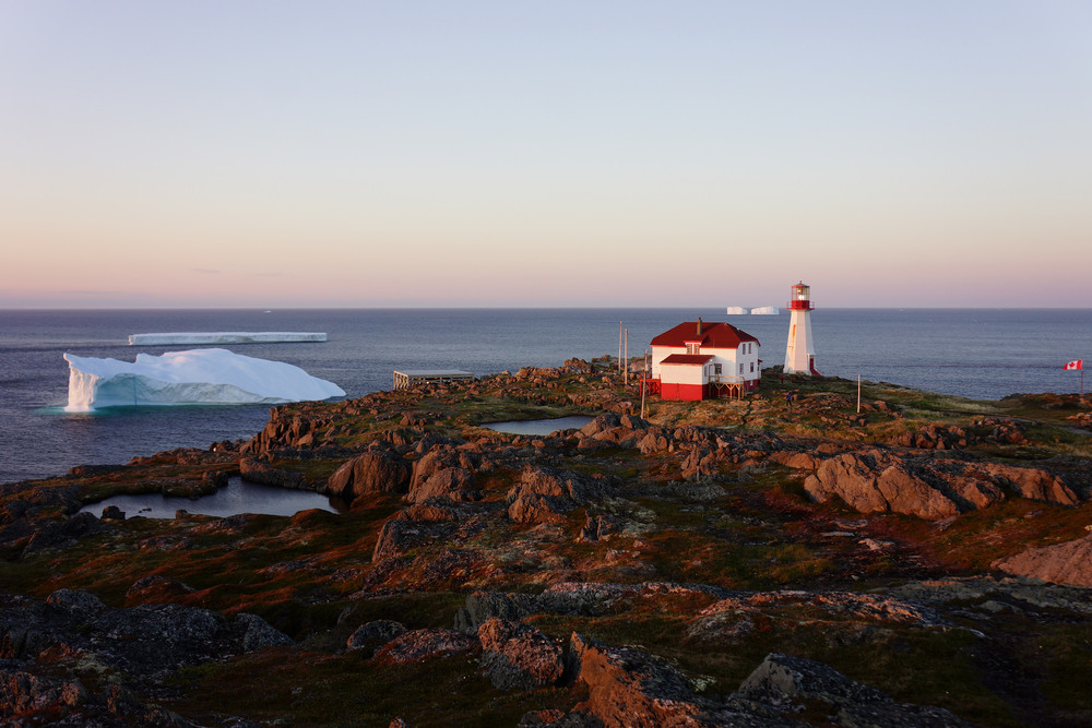 Icebergs at sunset behind Quirpon Lighthouse Inn