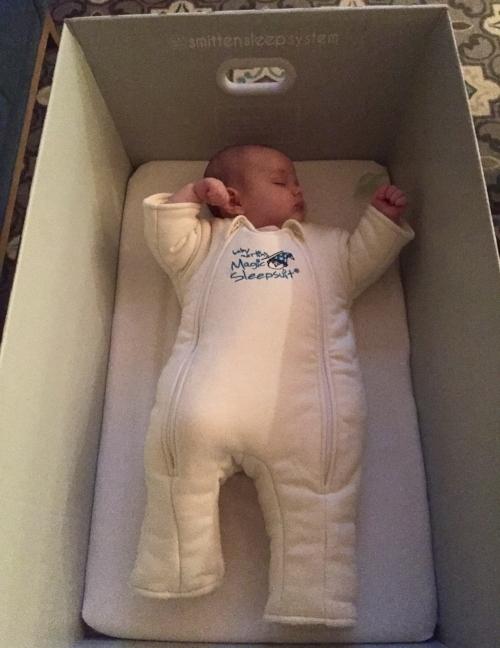 My little astronaut naps in her Sleepsuit.