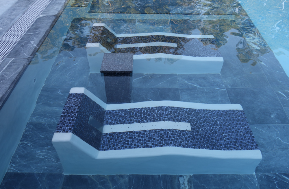 This custom pool and spa project located in Long Island, NY was designed and installed by The Platinum Group. The project features custom hydro-massage loungers and Fluvo wellness products.