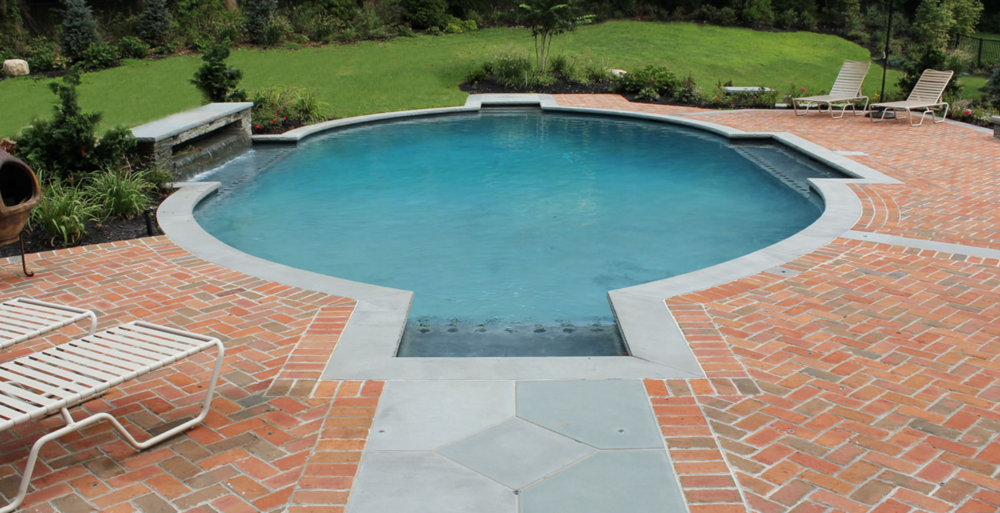 Benefits of Hiring a Gunite Pool Builder for Your Swimming Pool Project in Brookville, NY