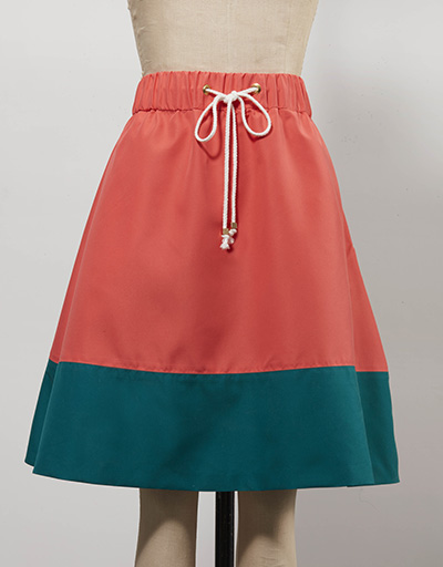 salmon colored and forest green women's golf skirt