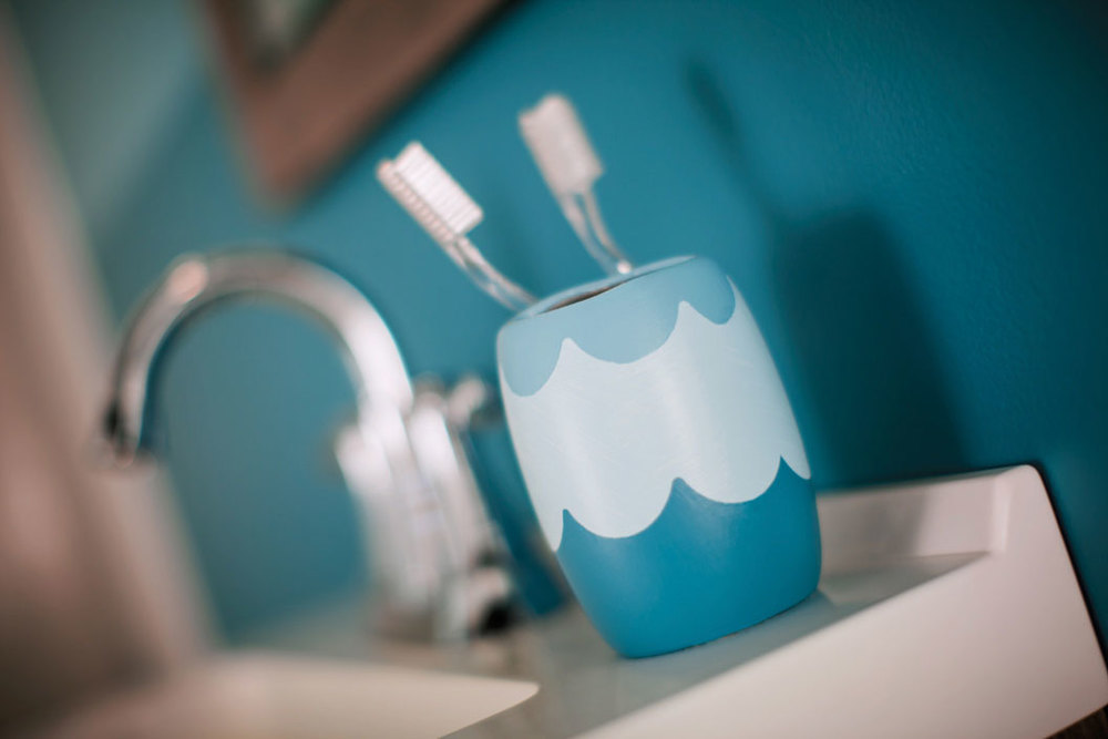 TRG image of sink with toothbrush holder.