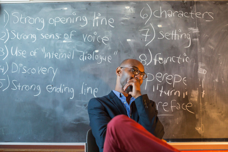 professional photography image of teacher in front of chalkboard