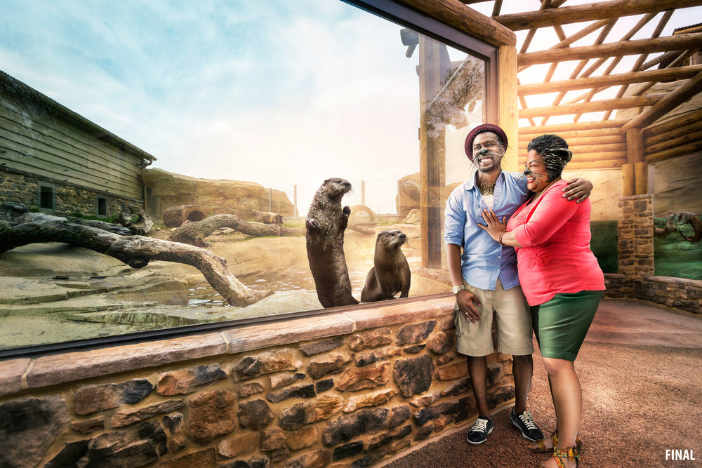 professional composite imagery of couple with otter features at otter exhibit at zoo