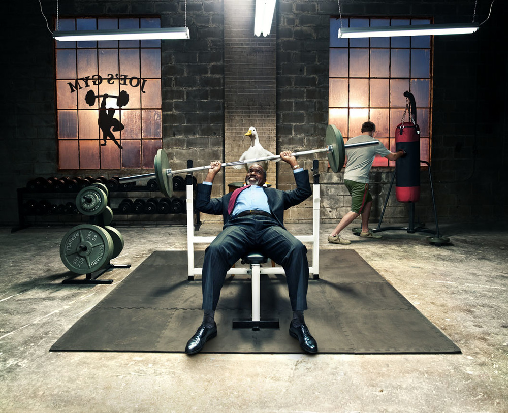 professional composite imagery photo of man lifting at gym with aflac duck