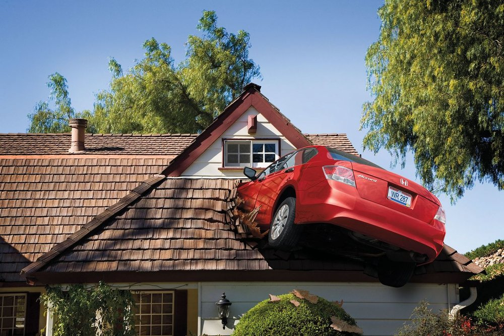 car-crashed-in-roof.jpg