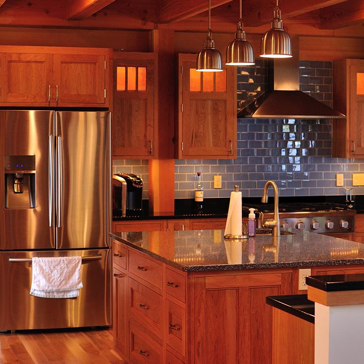 Lighted cabinets, under cabinet lighting, tile backsplash, stainless appliances
