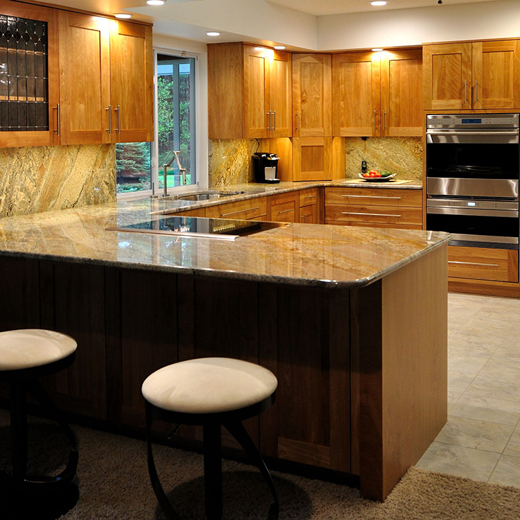 Granite Tops With Book-Matched Backsplashes
