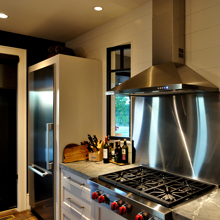 Wood Wall, Stainless Backsplash, Wolf Rangetop, Refrigerator Enclosure, Soapstone Tops