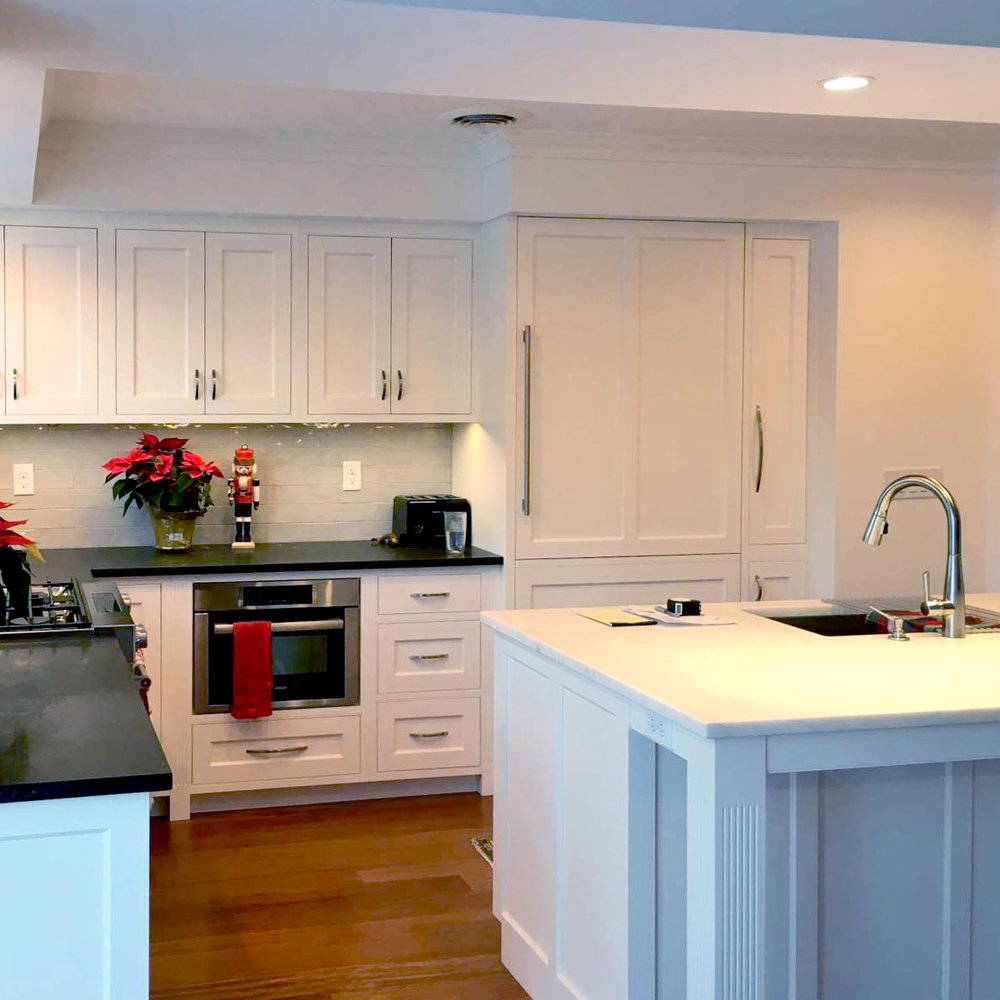 Fluted Stiles on Base Cabinetry,Brazilian Cherry Wood Floors,