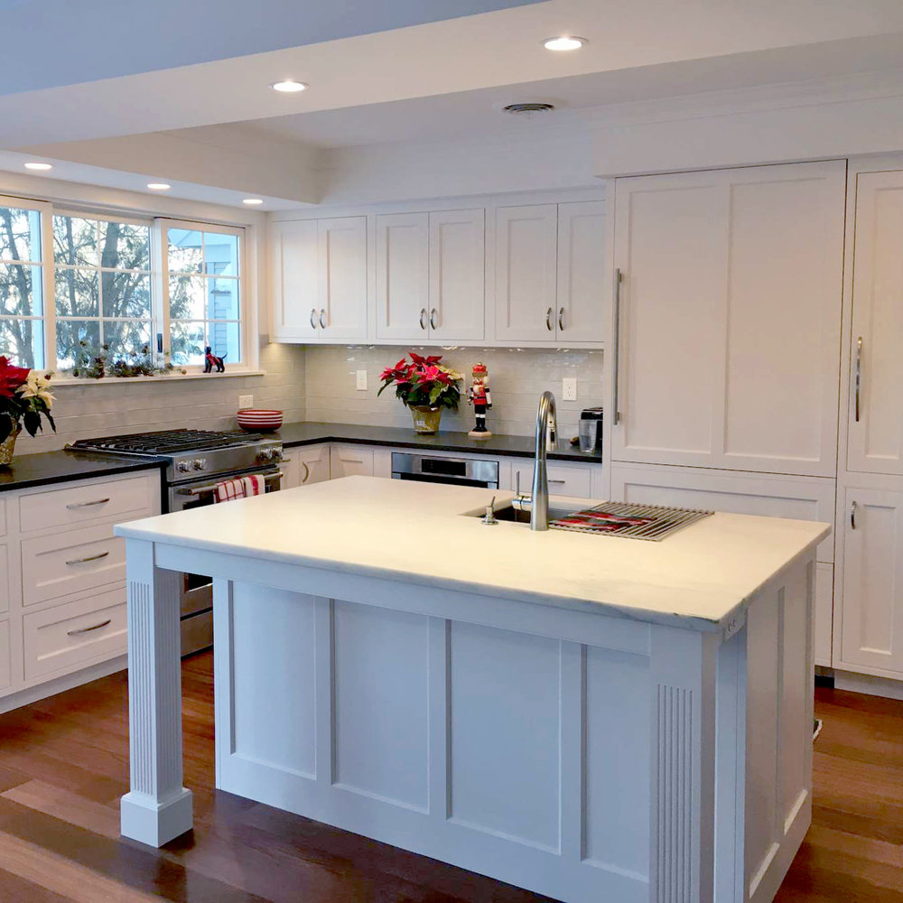 Danby Marble Island Top,Fluted islandLegs,Soffits with Lighting define kitchen area