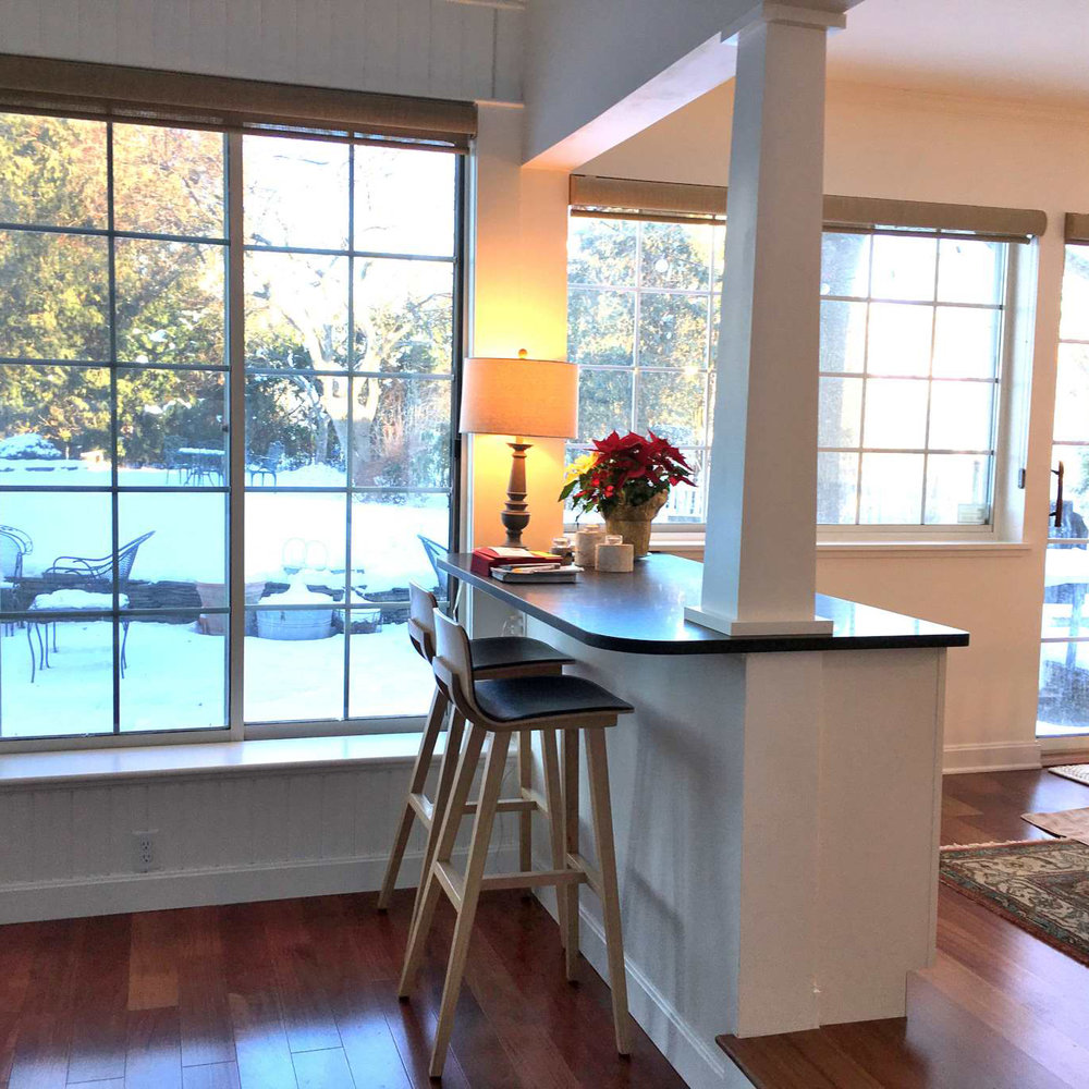 New opening to 4 season room. Removed window and door. Added new tapered column, cabinetry, countertop for sit-down.