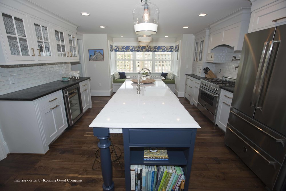 Soapstone Countertops, Under Counter Beverage Refrigeration, Island End Bookcase and Turned Legs,
