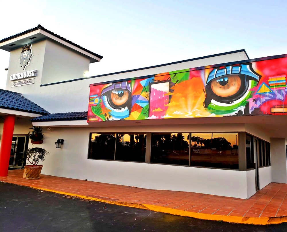 GrubHouse Miami entrance Lion eyes Welcome Mural