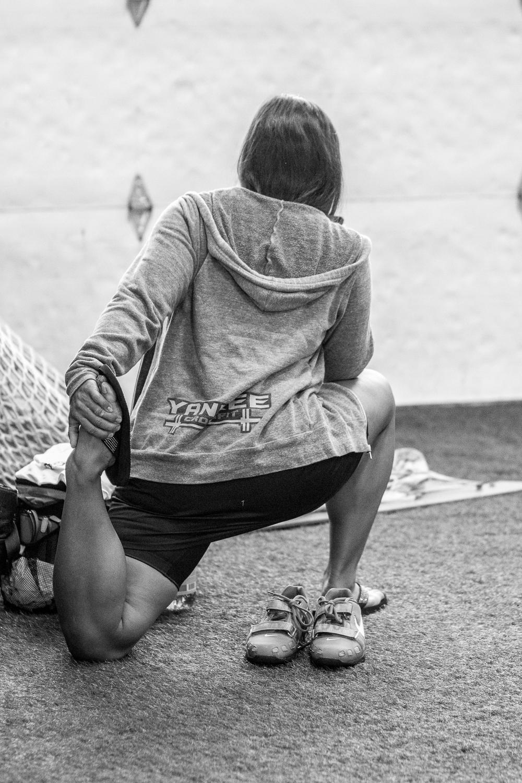 weightlifter-stretching-warm-up-weightlifting-meet.jpg