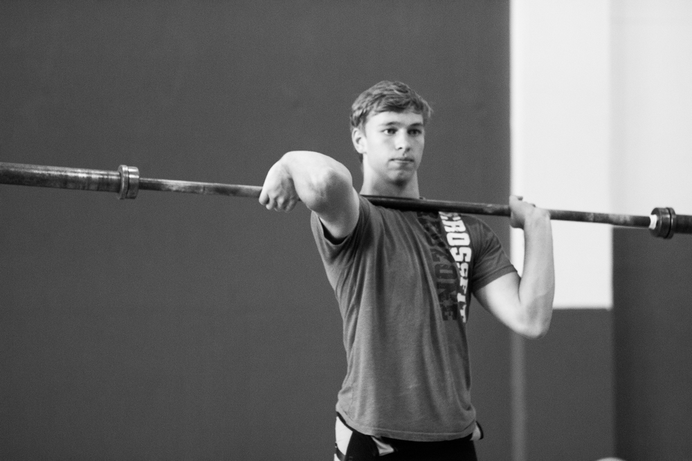 youth-weightlifter-stretching-barbell.jpg