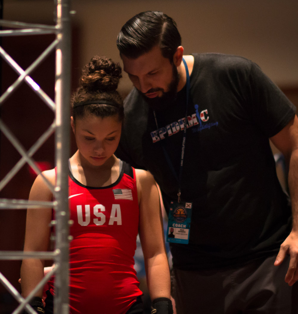 Her coach and Step-Father: Miles Ashworth from  Epidemic Weightlifting .