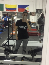 Posing and really trying hard not to flex in her Everyday Lifters' shirt! She is wearing a small.