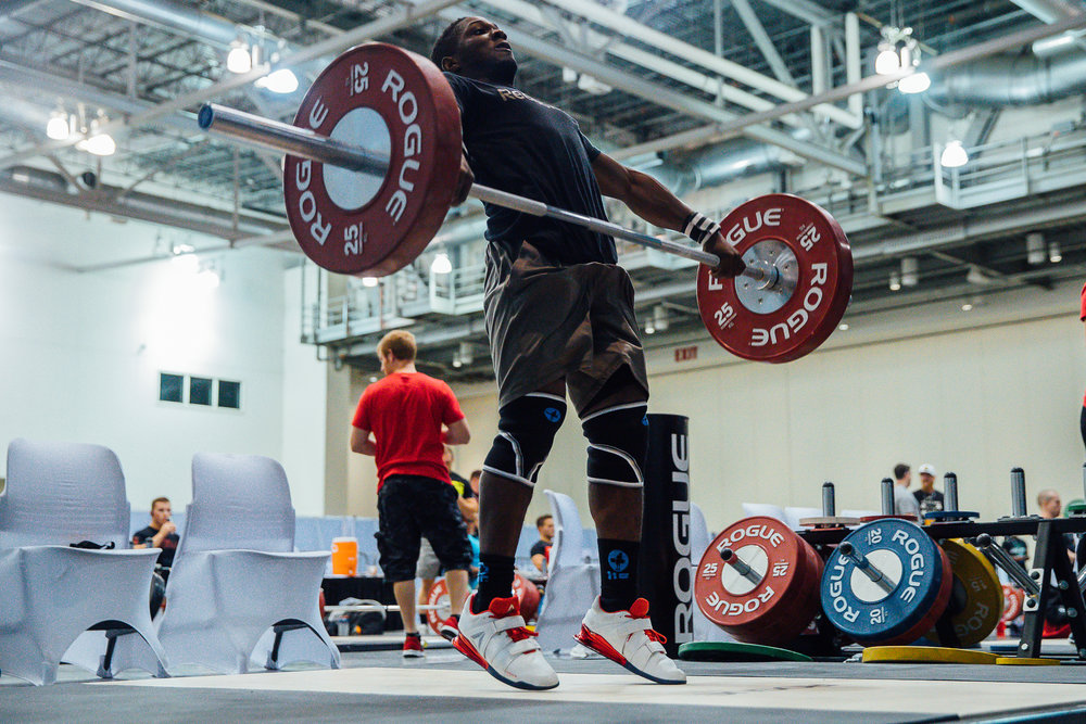 """While warming up, CJ actually missed one of his snatches. As a weightlifter I stopped breathing and as a photographer I got the hell out of the way!!! I actually sent CJ a message apologizing if I had gotten to close while warming up. His response, """"It's totally fine."""""""