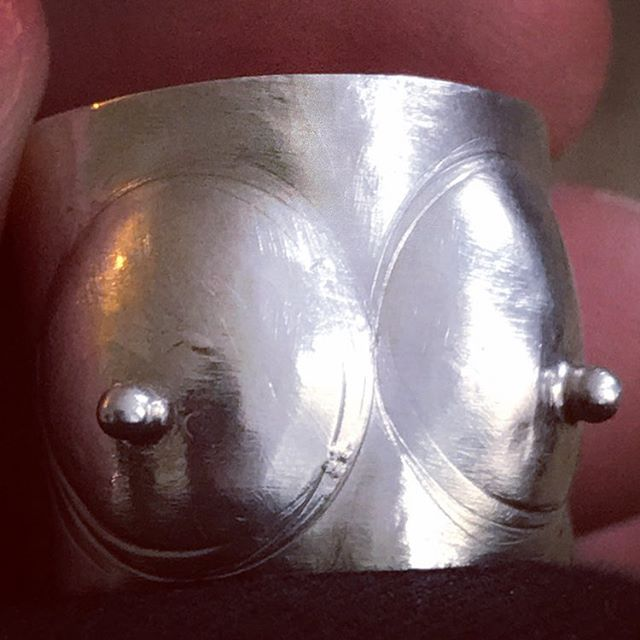 Pretty Little Titties Ring, sterling silver. Half the proceeds go to Breast Cancer Research Foundation! 👀