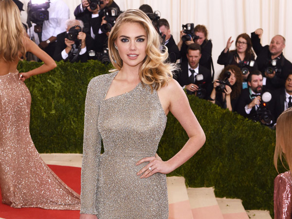 Model Kate Upton has a full-bust, but her small frame makes her the ideal in-between body type for bust friendly fashion. Larry Busacca / Getty Images