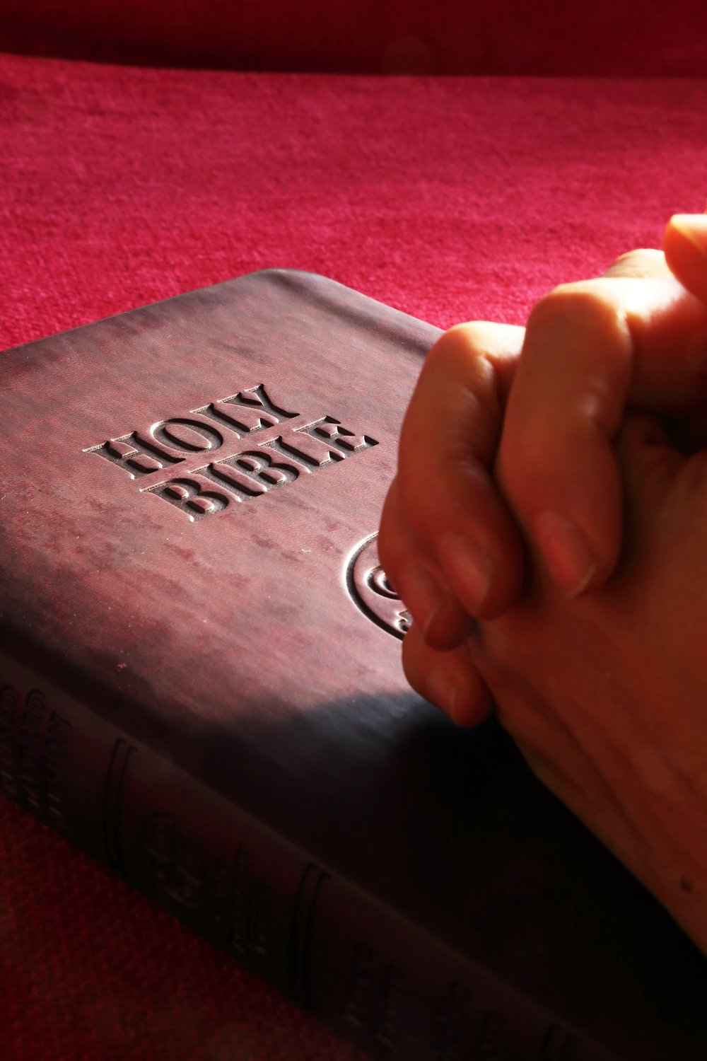 Praying hands on Bible.jpg