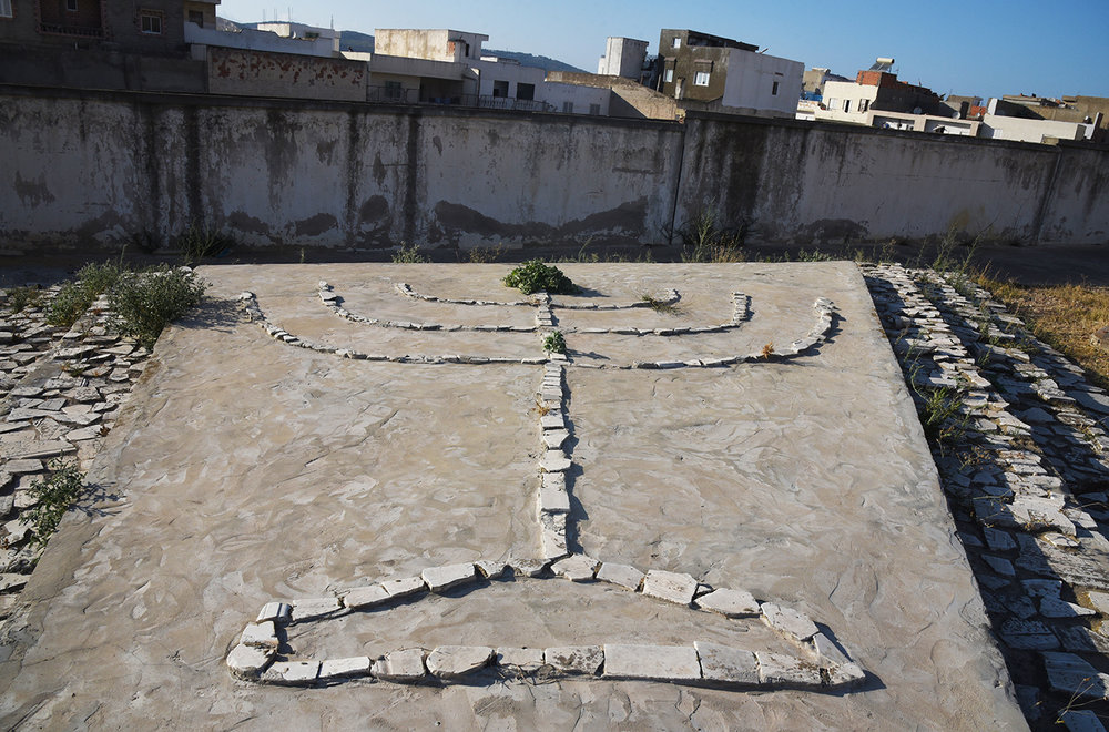 Bizerte Jewish cemetery. Menorah made from tomb fragments. Bizerte, Tunisia