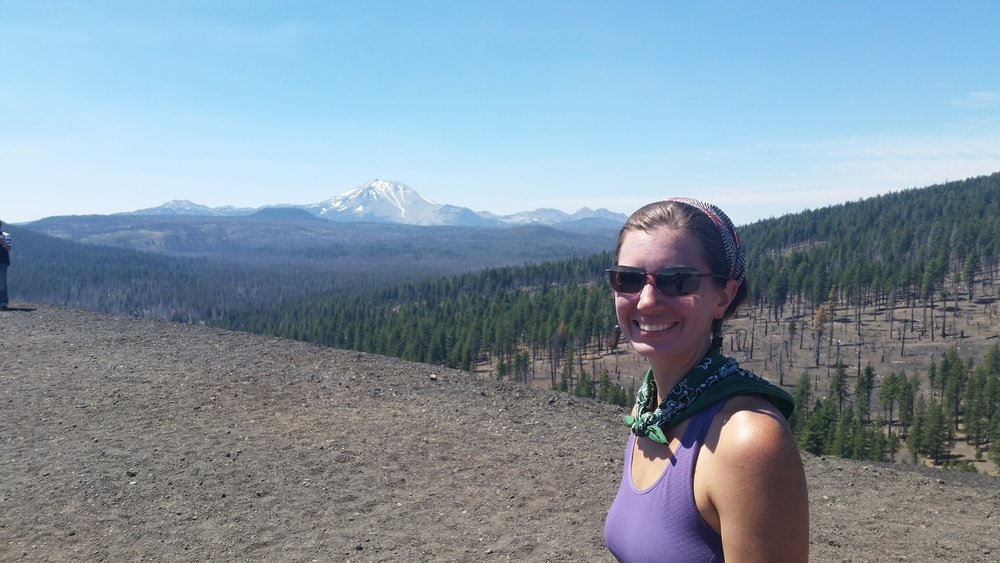Alli at the top of Cinder Cone, enjoying views of Lassen Peak.