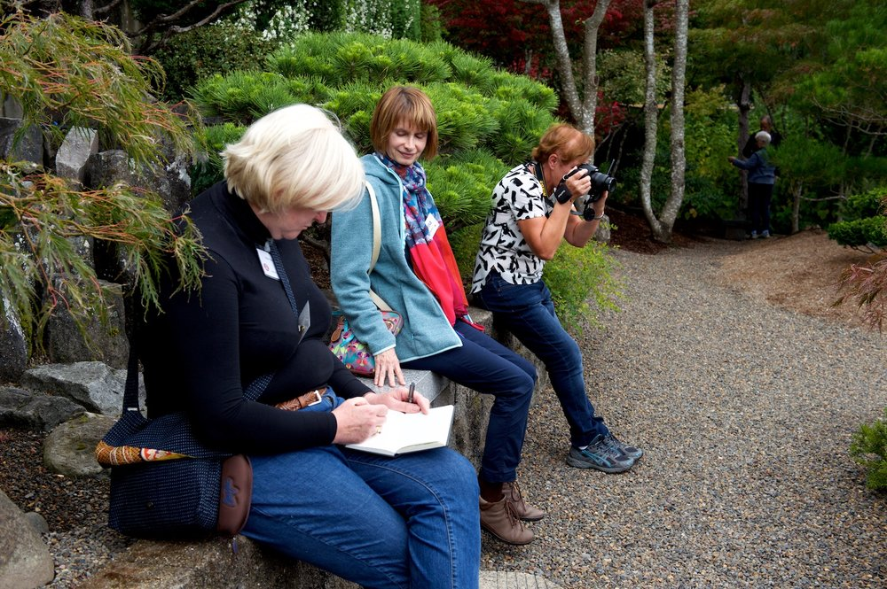 Helen Brown, sketching; Lorna Hitchin; Angie Cutmore (with camera) viewing from one of the strategically placed benches