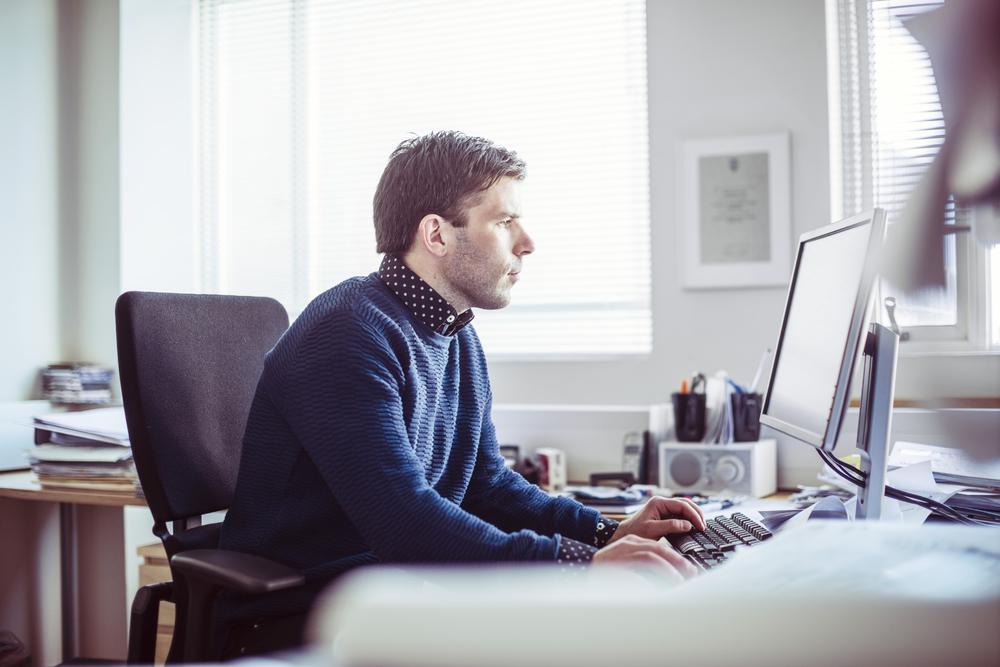 Male-professional-using-computer-in-brightly-lit-office-000073793503_Full.jpg