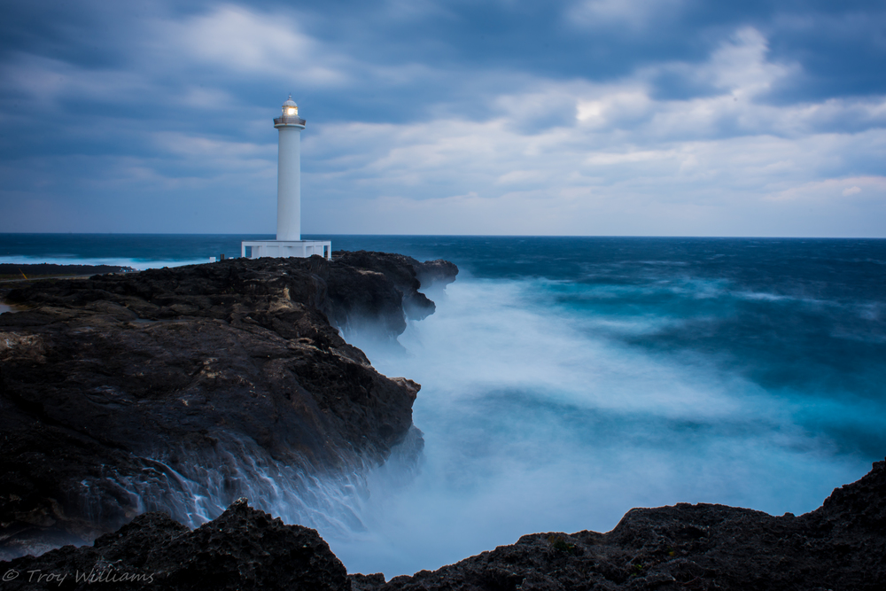 Cape Zanpa Misaki. The lighthouse draws visitors from all over the world. During rough seas, the waves crash over the cliffs and put on a mesmerizing show for visitors. Always good to have some wet weather gear handy when visiting during these times.