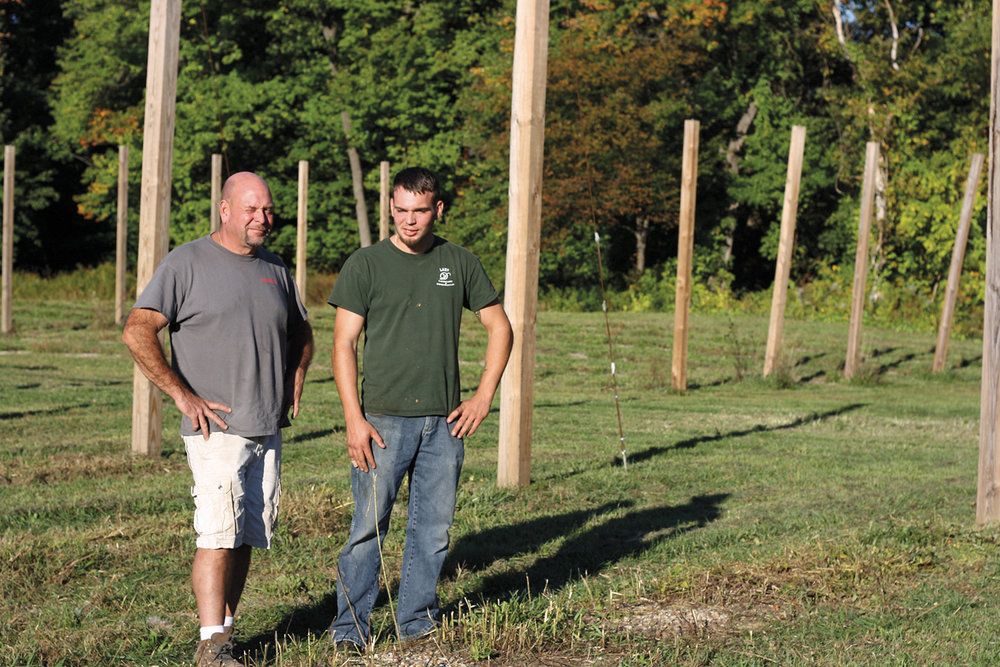 Dave and Luke Lepine in The Devil's Hopyard, now harvested and mowed in for the season, at Goats Peak Farm