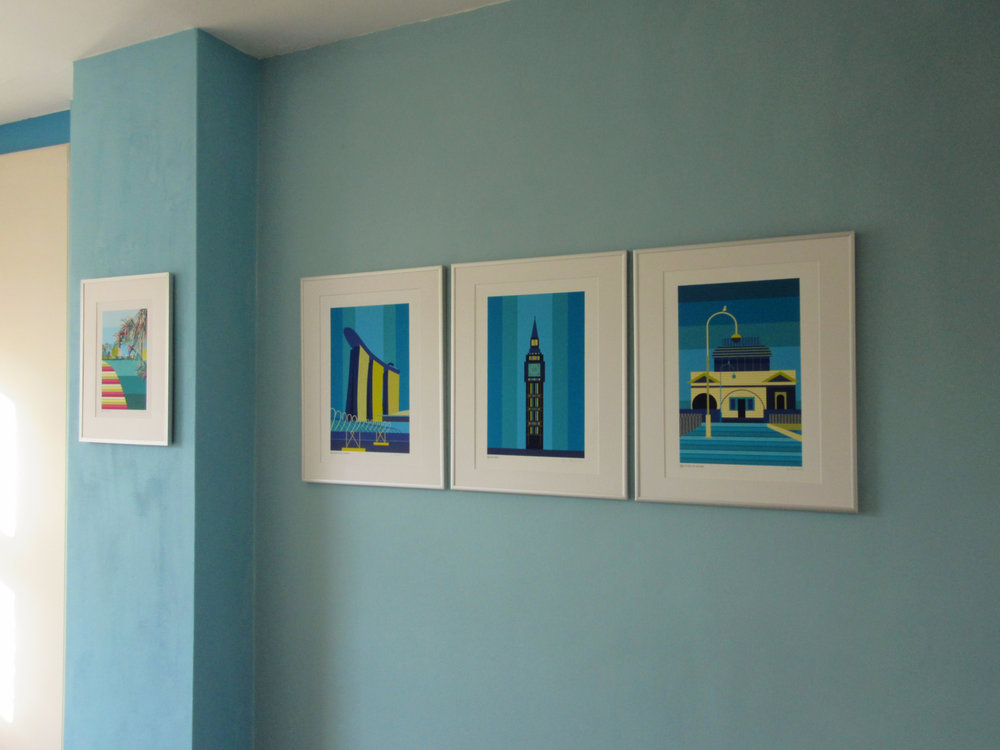 Gallery wall combining a mix of ready-made and customised art prints