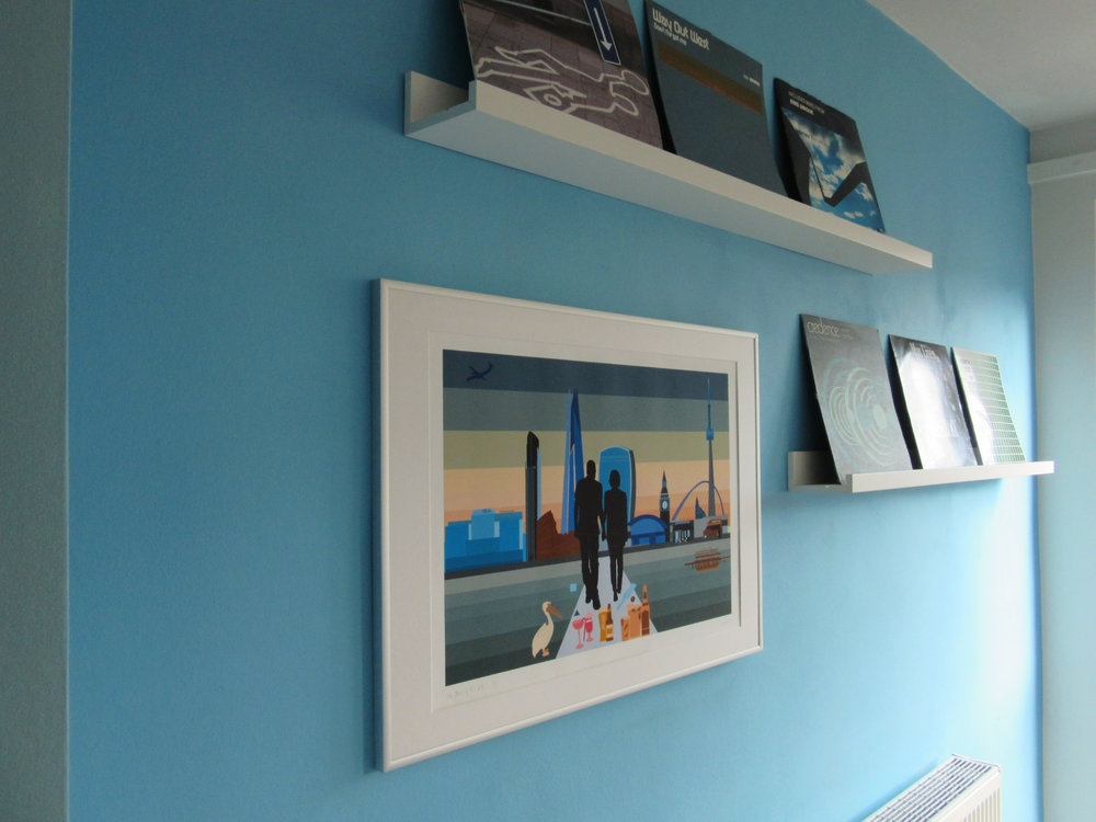 Feature wall with bespoke art print and vinyl picture ledges