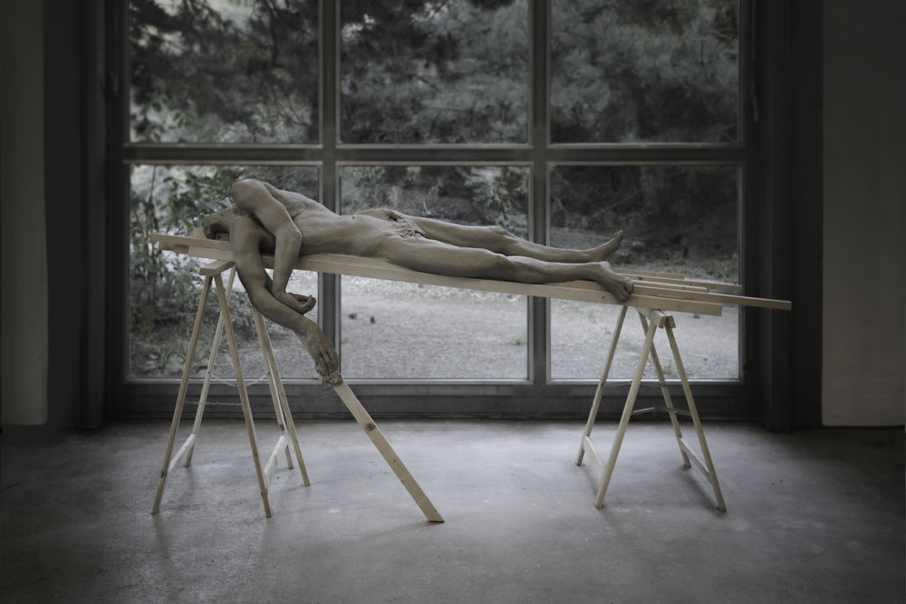 Kuebiko , 2016. Done at  S  tiftung I  nsel H  ombroich  in  Neuss, Germany.  Unfired Clay in wood support,  92 x 54 x 34 inches ( 233 x 135 x 86.36 cm).