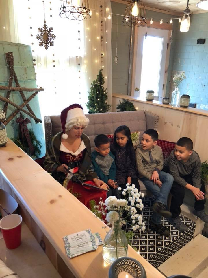 Mrs. Clause reading with children