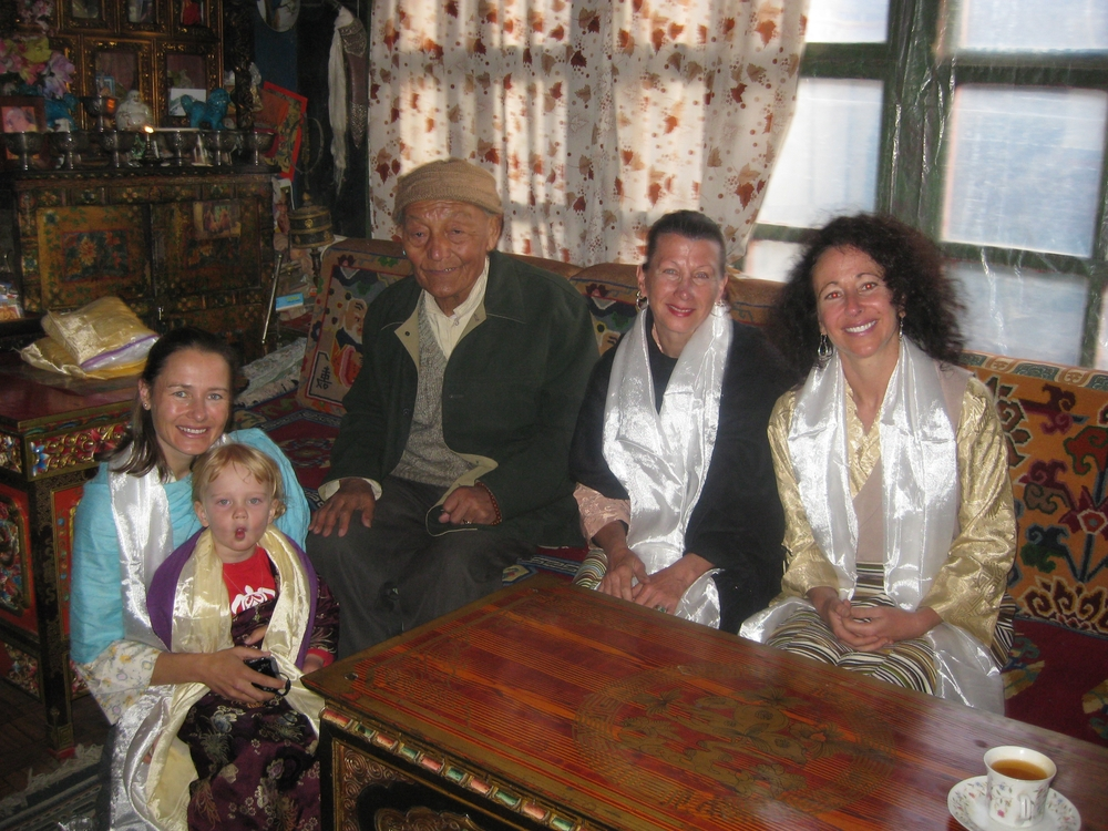 L-R: Dr. Sienna Craig with daughter Aida, Jigme Palbar Bista, Raja (king) of the kingdom of Lo, visual artist Maureen Drdak and composer Dr. Andrea Clearfield in the Raja's public audience room, 2008.