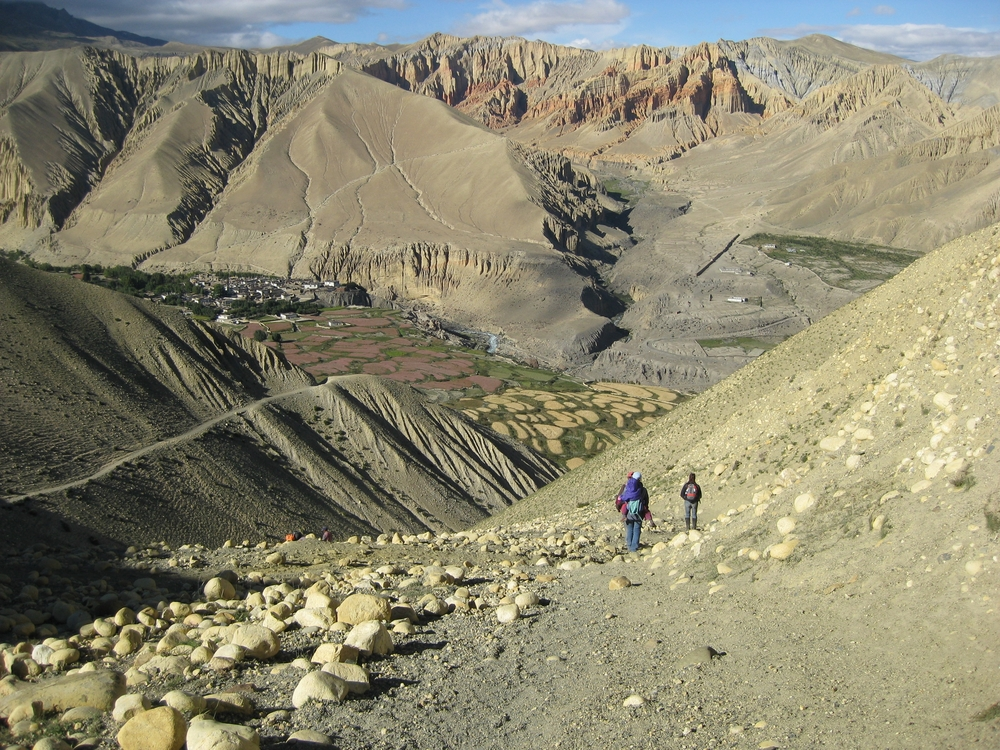 Dr. Sienna Craig, Aida and maureen drdak approach the Loba village of Ghemi in Ghemi prefecture, Lo, Upper Mustang, Nepal, 2008.