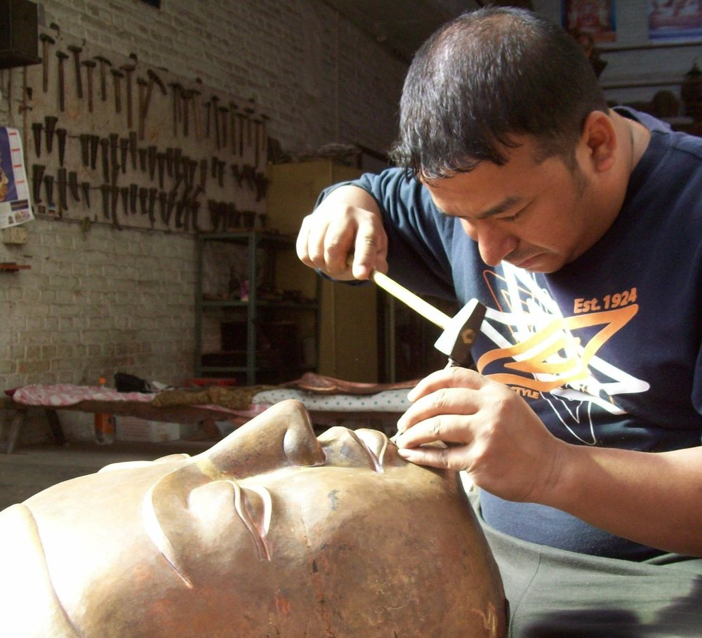 Repoussé Master Rabindra Shakya working on a large Buddha head - Copy.JPG